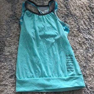 Blue tank top, attached sports bra from Justice.